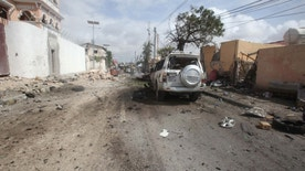 The wreckage of a private car destroyed during a suicide bombing is seen near the African Union's main peacekeeping base in Mogadishu, Somalia, July 26, 2016. REUTERS/Ismail Taxta - RTSJORN