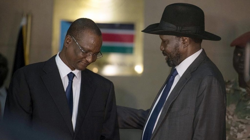 South Sudan's First Vice President Taban Deng Gai, left, speaks with President Salva Kiir, right.