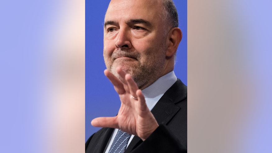 "European Commissioner for Economic and Financial Affairs Pierre Moscovici addresses the media at EU headquarters in Brussels on Wednesday July 27, 2016. The European Union's executive has refrained from calling for heavy fines against Spain and Portugal over budgetary breaches over the past years and sought to set ""new fiscal paths"" for the two Iberian countries. (AP Photo/Geert Vanden Wijngaert)"