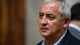 In this July 22, 2016 photo, Guatemala's jailed, former President Otto Perez Molina attends a pre-trial hearing in Guatemala City. A Guatemalan judge has formally ordered prosecutors to investigate Perez Molina and his ex-VP Roxanna Baldetti in a corruption case, on Wednesday, July 27, 2016. It's the second graft case against Perez Molina and the third against Baldetti. They deny the accusations. (AP Photo/Moises Castillo)