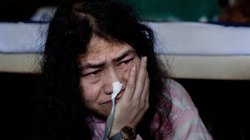 FILE - In this Monday Nov. 3, 2014 file photo, India's most famous prisoner of conscience Irom Sharmila, 42, cries by her bed at the Jawaharlal Nehru Hospital where she is kept in judicial custody on charges of attempted suicide, a crime in India, in Imphal, in the northeastern Indian state of Manipur. The frail activist who has been on a hunger strike for nearly 16 years to protest alleged brutality by India's military told a court on Tuesday, July 26, 2016, that she'll give up her fast on Aug. 9 and stand as an independent candidate in elections early next year. Sharmila has not eaten voluntarily since November 2000, when she began her protest against an Indian law that suspends many human rights protections in areas of conflict. She was arrested three days after starting her fast on charges of attempting suicide and has since been force fed through a tube in her nose. (AP Photo/Anupam Nath, File)