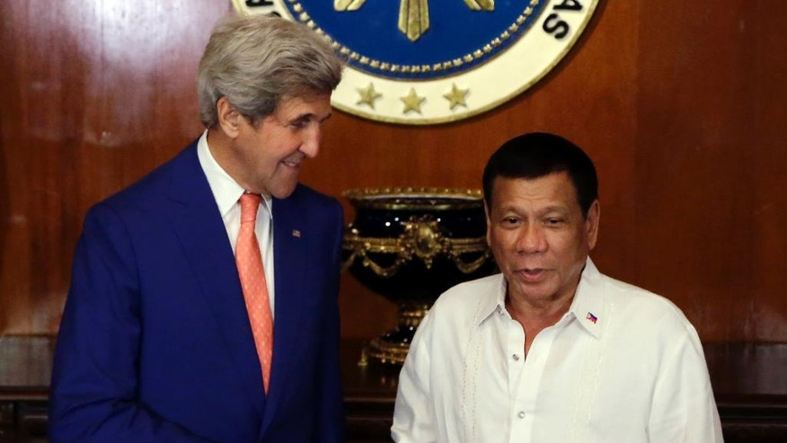 Philippine President Rodrigo Duterte, right, shakes hands with U.S. Secretary of State John Kerry during his visit at the Malacanang presidential palace in Manila, Philippines on Wednesday, July 27, 2016. (AP Photo/Aaron Favila, Pool)