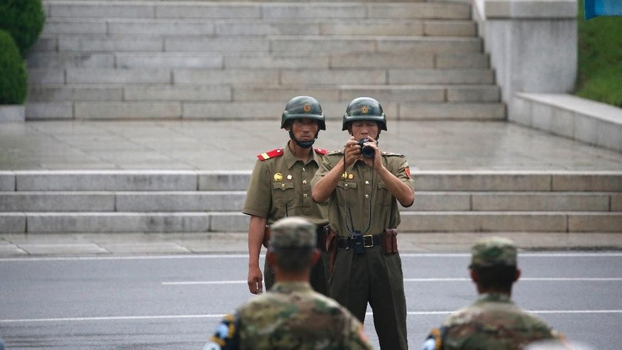North Korean soldiers keep watch toward the south during a ceremony marking the 63rd anniversary of the signing of the Korean War ceasefire armistice agreement at the truce village of Panmunjom, South Korea, Wednesday, July 27, 2016.  (Kim Hong-Ji/Pool Photo via AP)