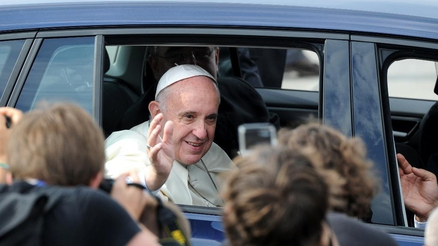 Pope Francis  leaves the Krakow's military airport , Poland,  Wednesday, July 27, 2016. The world is at war, but it is not a war of religions, Pope Francis said Wednesday as he traveled to Poland on his first visit to Central and Eastern Europe in the shadow of the slaying of a priest in France.  (AP Photo/Alik Keplicz)