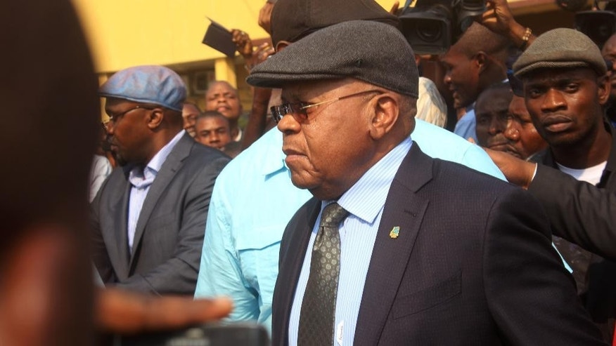 Congo opposition leader Etienne Tshisekedi, center, is greeted by supporters at the airport in Kinshasa, Congo, Wednesday, July 27, 2016. The leader of Congo's main opposition party returned to the country Wednesday after two years away for medical reasons and as tensions grow ahead of November presidential elections. (AP Photo/John Bompengo)