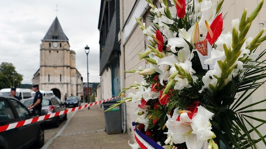 July 27, 2016: A wreath of flowers from the Muslims of France Association is placed outside the church where a priest was killed by Islamic terrorists in Saint-Etienne-du-Rouvray, Normandy, France.