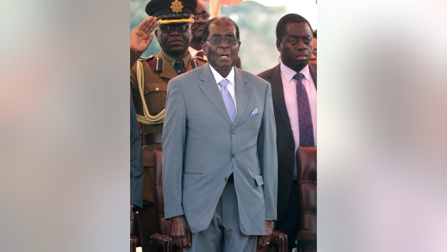 "Zimbabwean President Robert Mugabe sings the national anthem before addressing the Zimbabwe National Liberation War Veterans Association, at the party headquarters, in Harare, Wednesday, July, 27, 2016. Zimbabwe's 92-year-old president on Wednesday said the longtime loyalists who turned against him last week should face ""severe"" punishment, and he vowed to stay in power for ""a long time."" (AP Photo/Tsvangirayi Mukwazhi)"