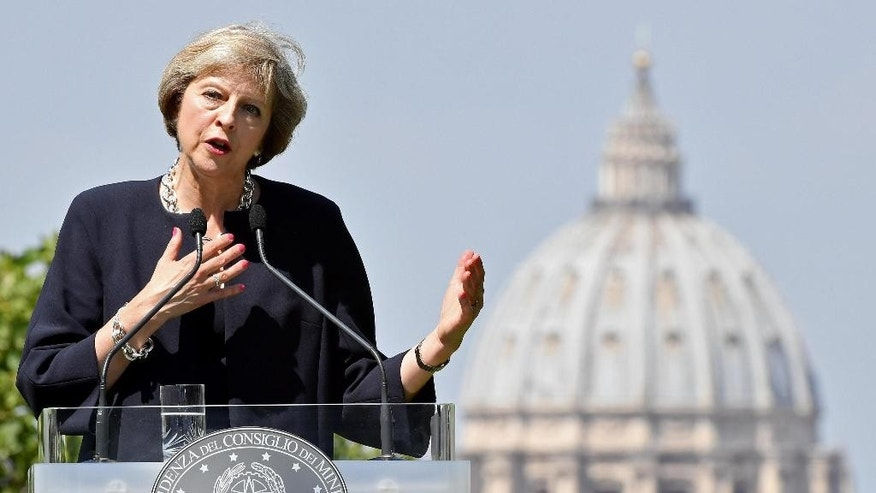 British Prime Minister Theresa May speaks during a press conference after meeting with Italian Premier Matteo Renzi in Rome Wednesday, July 27, 2016. In the background the dome of St. Peter's Basilica. (Ettore Ferrari/ANSA via AP)