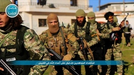 FILE - This file photo posted on the Twitter page of Syria's al-Qaida-linked Nusra Front on April 1, 2016, shows fighters from al-Qaida's branch in Syria, the Nusra Front, marching toward the northern village of al-Ais in Aleppo province, Syria. The leader of Syria's Nusra Front said Thursday, July 28, 2016 that his group is changing name, and claims it will have no more ties with al-Qaida. (Al-Nusra Front via AP, File)