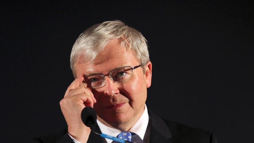 In this Sept. 6, 2013, file photo, former Australian Prime Minister Kevin Rudd adjusts his glasses during a speech at a pre-election rally in Mt. Druitt, Australia. Australia's government has rejected a request by Mr Rudd that it back his late bid for the top United Nations job. The decision by Prime Minister Malcolm Turnbull on Friday July, 29, 2016 effectively crushes Rudd's hopes of nabbing the post after he spent months lobbying for government support.(AP Photo/Rob Griffith, File)