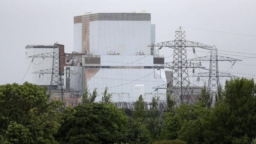 General view of Hinkley Point B power station in Somerset, England, Thursday July 28, 2016. French energy company EDF is due to decide whether to go ahead with a major nuclear power plant project in southwest England that some consider too costly.  (Andrew Matthews/PA via AP)