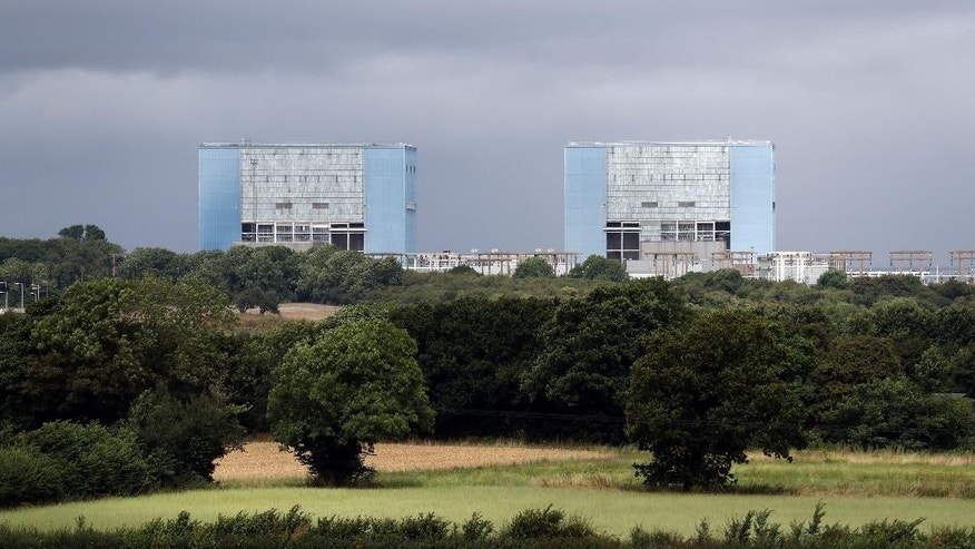 General view of Hinkley Point A Magnox nuclear power station in Somerset, England, Thursday July 28, 2016. French energy company EDF is due to decide whether to go ahead with a major nuclear power plant project in southwest England that some consider too costly.  (Andrew Matthews/PA via AP)