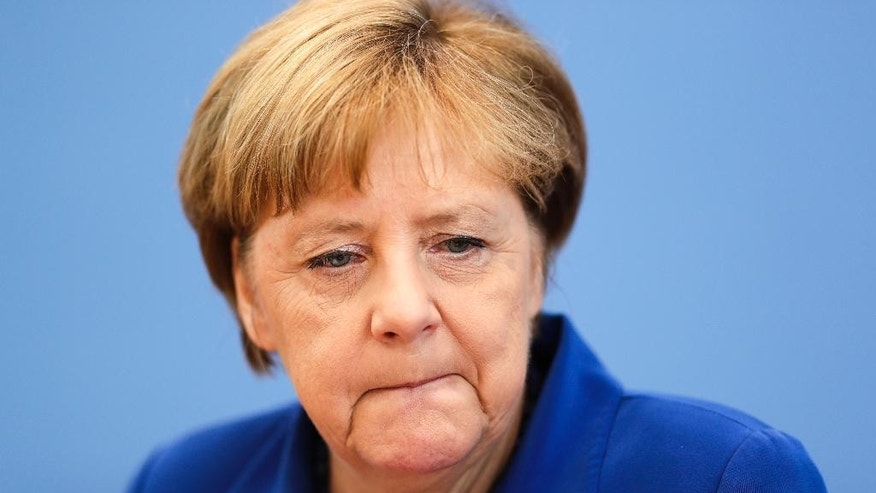 "German Chancellor Angela Merkel attends a news conference in Berlin Thursday, July 28, 2016 . Chancellor Angela Merkel says the fact that two men who came to Germany as refugees carried out attacks claimed by the Islamic State group ""mocks the country that took them in."" Merkel pledged at a news conference to do everything to clear up the ""barbaric acts,"" find out who was behind them and bring them to justice. (AP Photo/Markus Schreiber)"