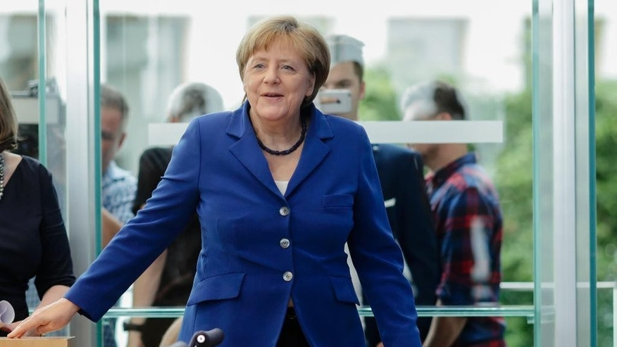 "German Chancellor Angela Merkel arrives for a  news conference in Berlin Thursday, July 28, 2016. Chancellor Angela Merkel says the fact that two men who came to Germany as refugees carried out attacks claimed by the Islamic State group ""mocks the country that took them in."" Merkel pledged  to do everything to clear up the ""barbaric acts,"" find out who was behind them and bring them to justice.  (AP Photo/Markus Schreiber)"