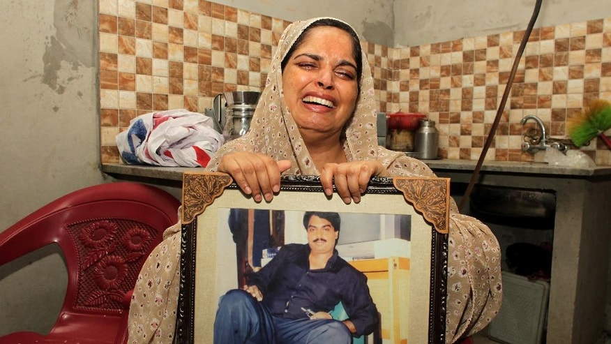 Humaira Bibi, sister of Zulfikar Ali, convicted of drug crimes, cries in Lahore, Pakistan, Wednesday, July 27, 2016. The sister of a Pakistani convicted of drug crimes has appealed the Indonesian government to spare the life of her ailing brother who is expected to be executed by a firing squad along with 12 others in the next 48 hours. (AP Photo/K.M. Chaudary)