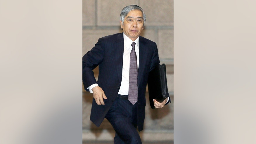 Governor of the Bank of Japan Haruhiko Kuroda arrives at its headquarters for a policy meeting in Tokyo Friday, July 29, 2016.  Japan's central bank has opted for a modest expansion of its lavish monetary stimulus to help perk up sluggish growth and combat deflation.  The Bank of Japan ended a policy meeting on Friday by announcing it will expand purchases of assets from financial institutions to help inject more cash into the economy and pursue its 2 percent inflation target. (Kyodo News via AP)