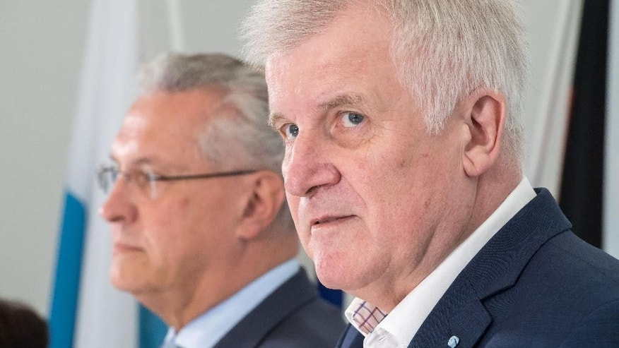 GERMANY OUT - Bavarian governor Horst Seehofer,right, and Bavaria's Interior Minister, Joachim Herrmann attend  a meeting of the Bavarian cabinet ,in Gmund, Germany, Tuesday, July 26, 2016.   In the most recent attack, a 27-year-old Syrian asylum-seeker set off a backpack laden with explosives and shrapnel Sunday night after being refused entry to a crowded music festival in the Bavarian city of Ansbach, killing himself and wounding 15 people.   ( Peter Kneffel/dpa via AP)