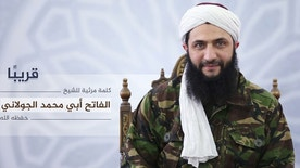 """Nusra Front leader Mohammed al-Golani undated photo released online on Thursday, July 28, 2016 to announce a video message that the militant group is changing name, and claims it will have no more ties with al-Qaida. In a video aired on the Syrian opposition station Orient TV and Al-Jazeera  al-Golani said the delinking from the terror network aimed to remove """"pretexts"""" by the U.S. and Russia to strike other rebel groups while claiming they are targeting Nusra. Arabic reads, """"coming soon, a video by the conqueror, Mohammed al-Golani.""""  (militant photo via AP)"""