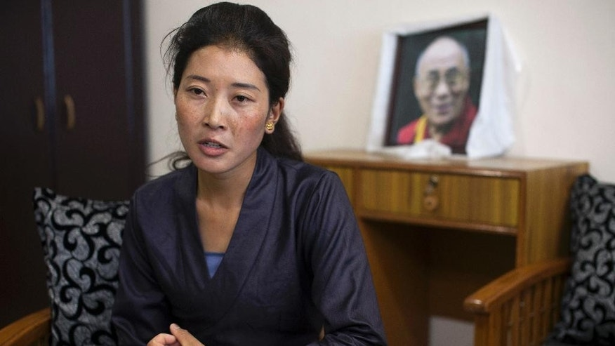 "In this Wednesday, July 27, 2016 photo, Nyima Lhamo, 26, speaks about her uncle Tenzin Delek Rinpoche, a prominent Tibetan religious leader who died in prison last year, during an interview with the Associated Press in Dharmsala, India. The price of Lhamo's escape was 65000 yuans (approximately 9700 USD), which she had to pay to an intermediary, but on a more personal level she had to leave her aging mother and a six-year-old daughter, whom she may never see again. ""It was necessary as the story of my uncle had to be told to the world. We don't trust what China is telling us and demand a thorough investigation into his death,"" she told the Associated Press speaking through two translators. (AP Photo/Ashwini Bhatia)"