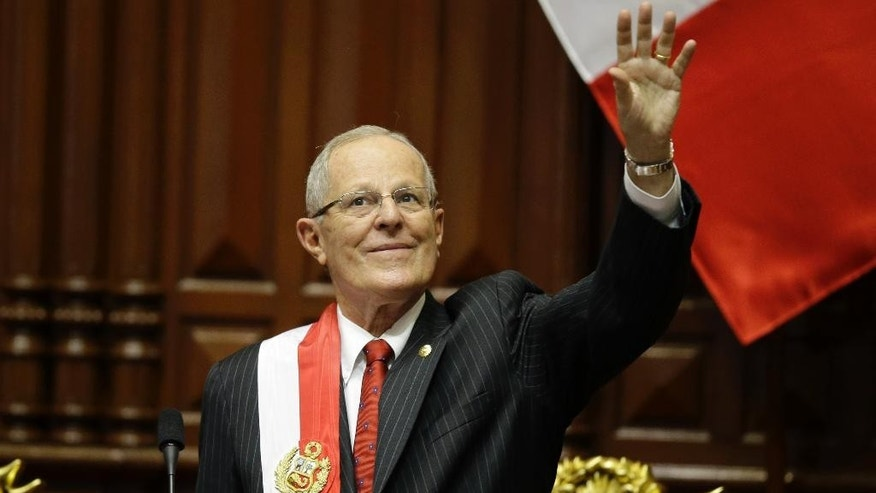 Peru's President Pedro Pablo Kuczynski waves during his inauguration ceremony at Congress in Lima, Peru, Thursday, July 28, 2016. Kuczynski assumed Peru's presidency Thursday with a Cabinet that shares his Ivy League, pro-business pedigree — a reliance on technocrats that could become a liability as he deals with an unfriendly congress and a resurgent left. (AP Photo/Martin Mejia)