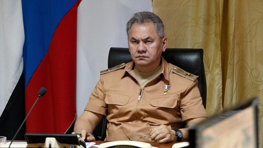 FILE - In this Saturday, June 18, 2016 file photo, Russian Defense Minister Sergei Shoigu visits the Hemeimeem air base in Syria. Shoigu said Thursday, July 28, 2016, Moscow is sending a top general and experts to Geneva at request of U.S. Secretary of State John Kerry to discuss the crisis surrounding the embattled Syrian city of Aleppo. (Vadim Savitsky/Russian Defense Ministry Press Service pool photo via AP, File)