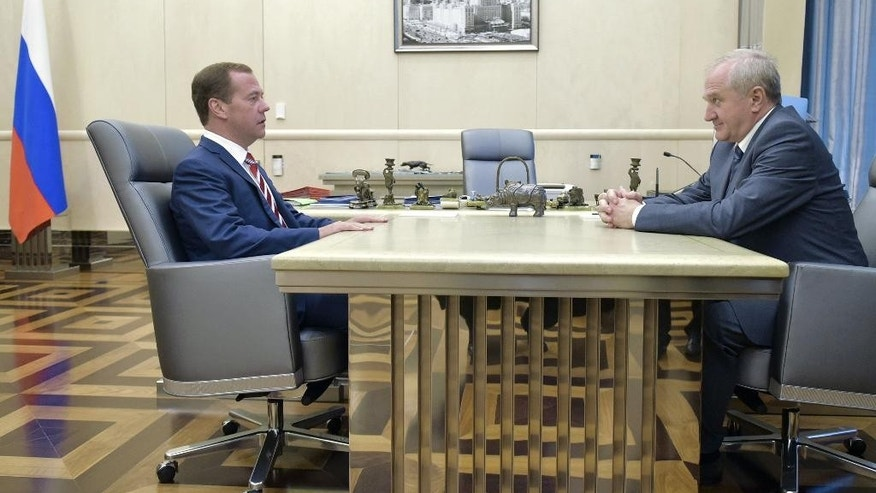 Russian Prime Minister Dmitry Medvedev, left, meets with Vladimir Bulavin, newly appointed head of the Federal Customs Service in Moscow, Russia on Thursday, July 28, 2016. (Alexander Astafyev/Sputnik, Government Press Service Pool Photo via AP)