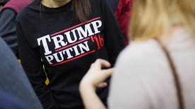 """FILE - In this Sunday, Feb. 7, 2016 file photo, a woman wears a shirt reading 'Trump Putin '16' while waiting for Republican presidential candidate Donald Trump to speak at a campaign event at Plymouth State University in Plymouth, N.H. Donald Trump just keeps giving Russian President Vladimir Putin more reasons to hope he wins the U.S. election, while raising serious questions about the Republican candidate's intentions toward the Kremlin. In his most recent outreach to Putin, Trump not only refused to condemn Russia's military takeover of Ukraine's Crimean Peninsula but said, if elected, he would consider recognizing it as Russian territory and lifting sanctions against Moscow. """"We'll be looking at that. Yeah, we'll be looking,"""" Trump told reporters on Wednesday, July 27, 2016.  (AP Photo/David Goldman, File)"""