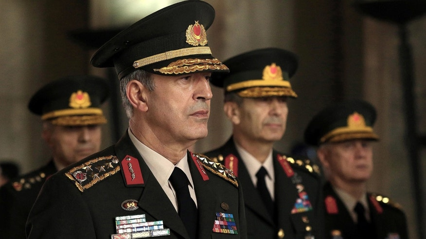 July 28, 2016: Chief of general staff General Hulusi Akar stands with other Military chiefs during a Supreme Military Council meeting with the Prime Minister Binali Yildirim at Ataturk's mausoleum in Ankara.