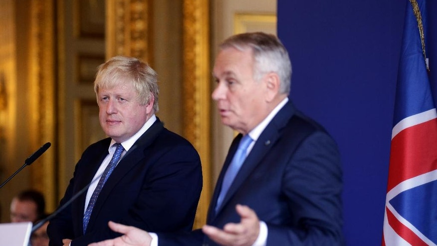 French Foreign Minister Jean Marc Ayrault, right, and British Foreign Secretary Boris Johnson address the media during their joint press conference at the ministry of foreign affairs in Paris, France, Thursday, July 28, 2016. New British Foreign Secretary Boris Johnson holds a press conference with his French counterpart Jean-Marc Ayrault during his first official visit to France in his post. (AP Photo/Thomas Padilla)