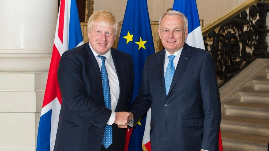 French Foreign Minister Jean Marc Ayrault, right, shakes hands with Britain Foreign Minister Boris Johnson prior to their meeting at the ministry of foreign affairs in Paris, France, Thursday, July 28, 2016. (Jeremy Lempin/Pool Photo via AP)