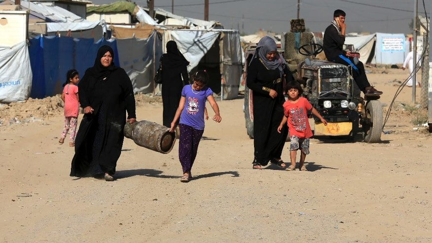 Internally displaced Iraqis prepare to return home to Anbar province, at a camp in southern Baghdad, Iraq, Thursday, July 28, 2016. More than 120 families have started returning to their homes in Anbar province after the region was liberated from the control of Islamic State group extremists. (AP Photo/Khalid Mohammed)