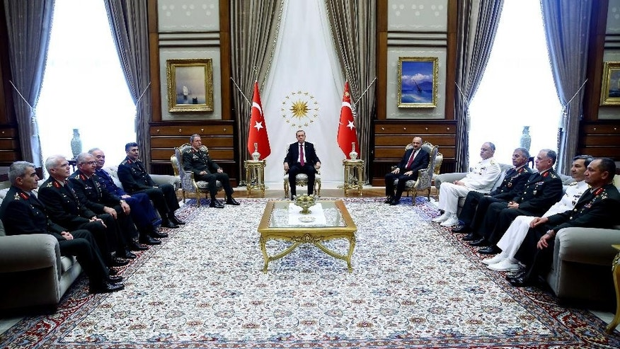 Turkey President Recep Tayyip Erdogan, rear center, with the Chief of general staff General Hulusi Akar, left, during a top-level military meeting at the Presidential palace in Ankara, Turkey, on Friday, July 29, 2016. Erdogan met with Hulusi Akar, the four-star general who retained his position as chief of staff following a Supreme Military Council meeting, as well as other top military brass of the Turkish armed forces. (Kayhan Ozer/Presidential Press Service, Pool Photo via AP)