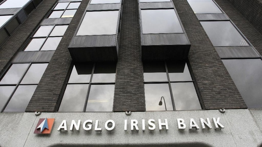 FILE - This is a Tuesday, Nov. 16, 2010  file photo of the offices of a branch of the Anglo Irish Bank in central Dublin, Ireland. Three former senior bankers have been imprisoned for their roles in hiding billions in losses at the defunct Anglo Irish Bank, the biggest accounting fraud in Irish corporate history.(AP Photo/Peter Morrison)