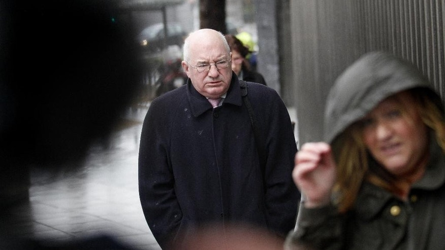 "FILE - This is a Wednesday, Feb. 5, 2014  file photo of former finance director of Anglo Irish Bank Willie McAteer as he arrives at Dublin Criminal Court, Ireland. Three former senior bankers have been imprisoned for their roles in hiding billions in losses at the defunct Anglo Irish Bank, the biggest accounting fraud in Irish corporate history. Judge Martin Nolan told the trio _ former Anglo executives Willie McAteer and John Bowe and former Irish Life and Permanent chief executive Denis Casey _ they were guilty of committing ""sham transactions"" designed to hide 7.2 billion euros ($8 billion) in deposit losses from shareholders in Anglo's 2008 earnings report.(AP Photo/Peter Morrison)"