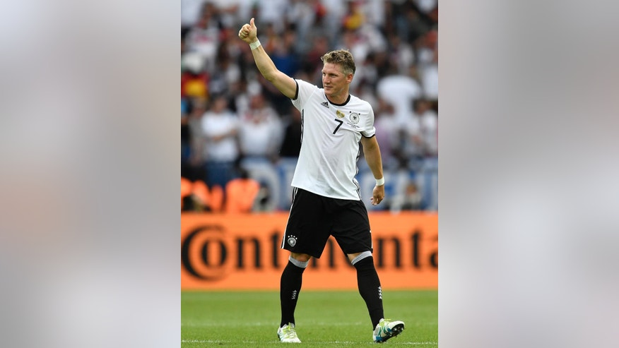 FILE - In this June 21, 2016 file photo Germany's Bastian Schweinsteiger gestures at the end of the Euro 2016 Group C soccer match between Northern Ireland and Germany at the Parc des Princes stadium in Paris, France. Germany captain Bastian Schweinsteiger said Friday, July 29, 2016 he is quitting the national team. The 31-year-old said in a Twitter statement that he's asked Germany coach not to include him in the line-up in future.  (AP Photo/Martin Meissner)