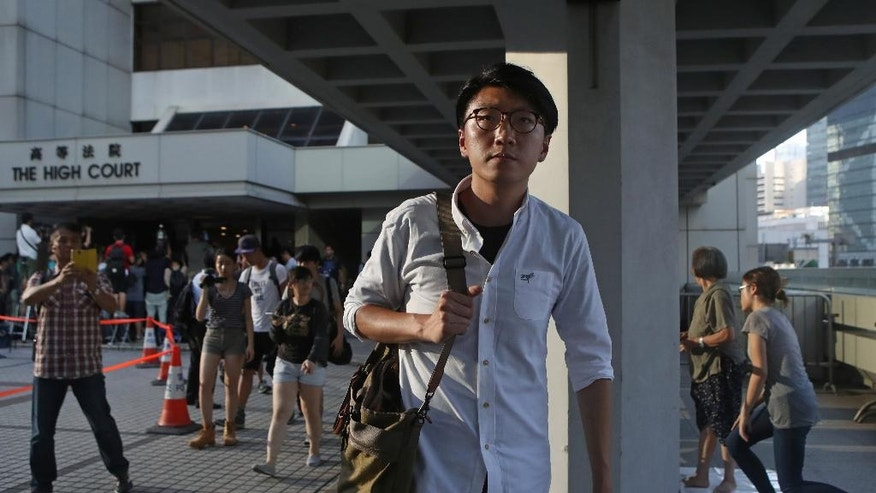 In this Wednesday, July 27, 2016, photo, ] high-profile localist candidate, Edward Leung of Hong Kong Indigenous, walks out from a court in Hong Kong as he was one of three people who filed the legal challenges this week after an election officer questioned him on his political stance. As the Asian financial center prepares for legislative elections in September, a new wave of radical political activists are planning to join the campaign, including some who advocate the once-unthinkable idea of independence from China. (AP Photo/Kin Cheung)