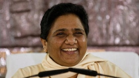 "FILE - In this Sept. 22, 2015 file photo, India's Bahujan Samaj Party (BSP) chief Mayawati smiles as she addresses journalists at a press conference in New Delhi, India. Indian police on Friday, July 29, 2016, arrested Hindu nationalist leader Dayashankar Singh on charges alleging he insulted senior female politician Mayawati by describing her as ""worse than a prostitute."" Singh later apologized for his remark, but Mayawati demanded his arrest as she rejected his accusation. (AP Photo/Saurabh Das, File)"