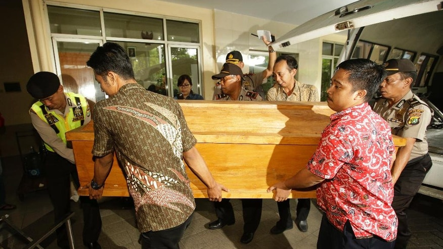 Indonesian police carry a coffin of death row prisoner Nigerians Seck Osmanu upon arrive at a funeral home in Jakarta, Indonesia, Friday, July 29, 2016. Indonesia executed four people convicted of drug crimes on Friday despite international protests and said it would decide later when as many as 10 others are put to death. (AP Photo/Achmad Ibrahim)
