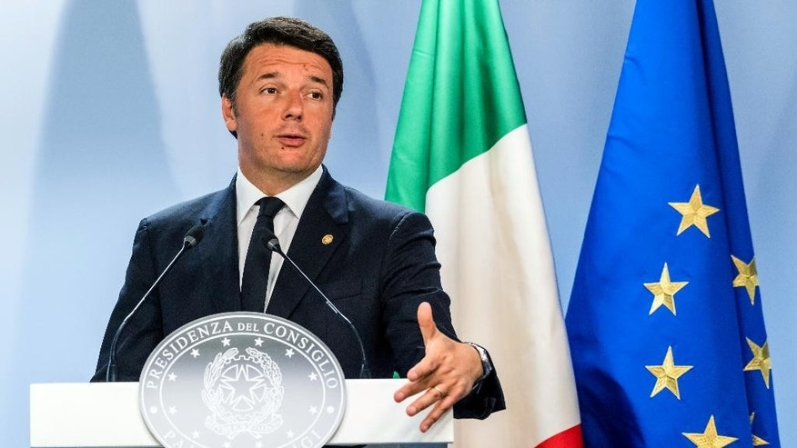 FILE - In this Wednesday, June 29, 2016 file photo, Italian Prime Minister Matteo Renzi speaks during an EU summit in Brussels. About a month on from Britain's vote to leave the European Union, there's little evidence that economic activity across the continent has been derailed yet. That's some reassurance for the 19-country eurozone as it faces a host of other problems, many of which relate to Italy, the bloc's third-largest economy. The Brexit vote has raised the stakes in Italian Premier Matteo Renzi's upcoming referendum on a raft of changes designed to streamline the country's political system. (AP Photo/Geert Vanden Wijngaert, file)
