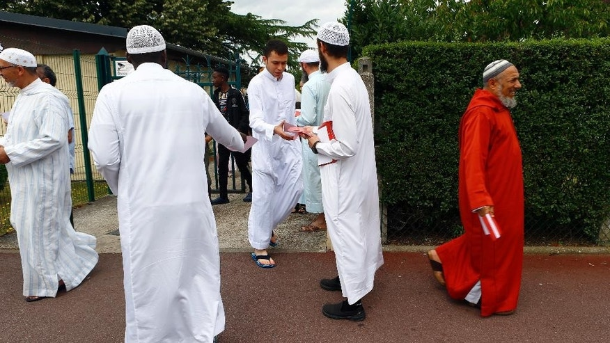 Muslim worshippers walk out after the friday prayer at the Yahya Mosque, in Saint-Etienne-du-Rouvray, Normandy, France, Friday, July 29, 2016. Four days after the hostage taking in Saint-Etienne-du-Rouvray, officials and worshippers of the muslim community paid tribute to Priest Jacques Hamel and Christian community. (AP Photo/Francois Mori)