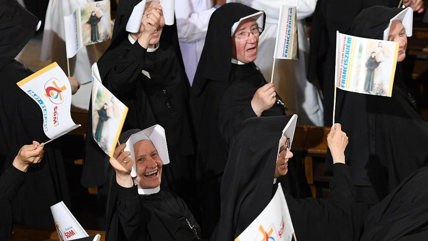 Nuns cheer as they wait for Pope Francis to arrive, at the Divine Mercy Sanctuary in Krakow, Poland, Saturday, July 30, 2016. (Daniel Dal Zennaro/Pool Photo via AP)
