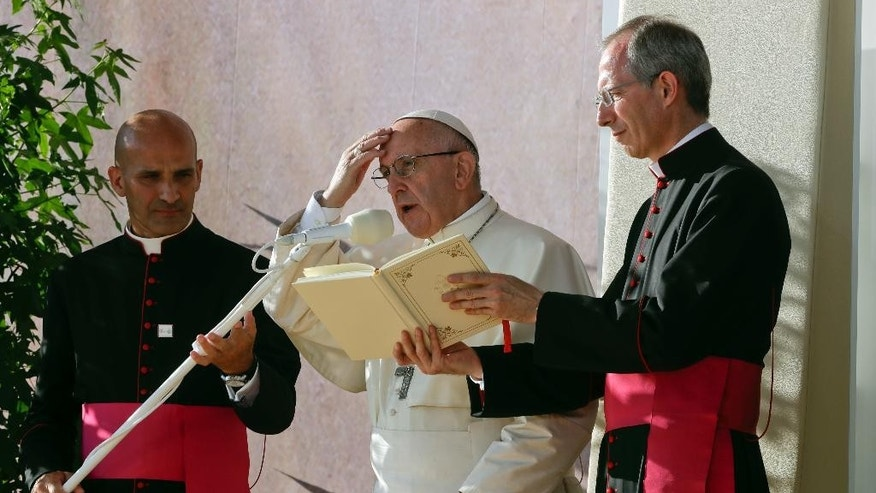 Pope Francis, center, attends the Via Crucis (Way of the Cross) with youths participating in World Youth Days, in Blonie Park, Krakow, Poland, Friday, July 29, 2016. (AP Photo/Gregorio Borgia)