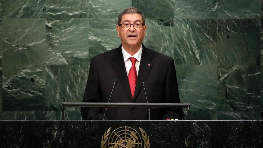 FILE- In this Sept. 27, 2015, file photo, Habib Essid, Head of Government of Tunisia, addresses the 2015 Sustainable Development Summit at United Nations headquarters. Tunisia's parliament passed a vote of no confidence in Prime Minister Habib Essid on Saturday, July 30, effectively disbanding the government of the U.S.-trained agricultural economist. (AP Photo/Richard Drew, File)