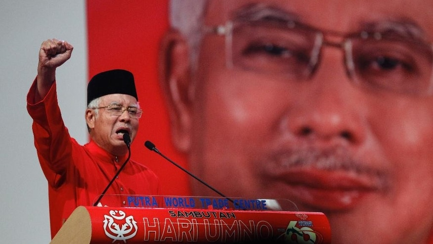"FILE - In this May 11, 2015 file photo, Malaysian Prime Minister Najib Razak addresses delegates during his speech at the Malaysia's ruling party United Malays National Organization's (UMNO) anniversary celebration in Kuala Lumpur, Malaysia.  Amnesty International has warned that a Malaysian security law that comes into force Monday, Aug. 1, 2016,  will give the government ""unchecked and abusive powers"" in a blow to human rights. (AP Photo/Joshua Paul, File)"