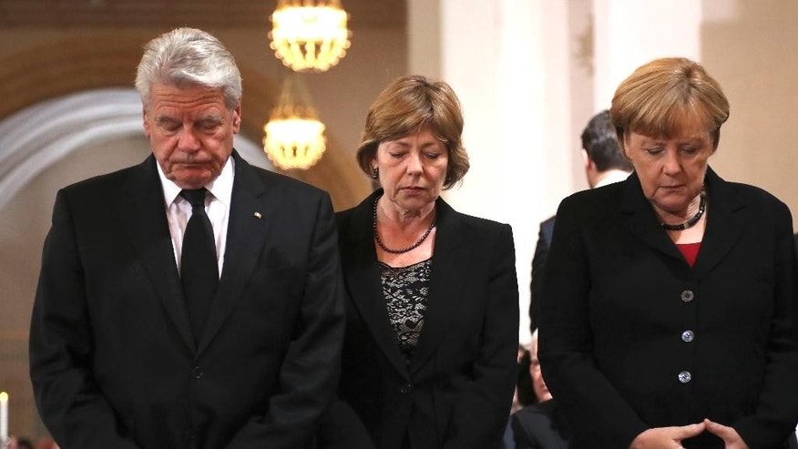 From left : German President Joachim Gauck, his partner Daniela Schadt and German chancellor Angela Merkel attend a memorial service for the nine victims of a shooting at the Olympia shopping center in Munich, Germany, Sunday, July 31, 2016. An 18-year-old German-Iranian man killed nine people and wounded over 30 others  on July 22, at a McDonald's restaurant and shopping mall in the city. He then killed himself.  ( (AP Photo/Matthias Schrader)