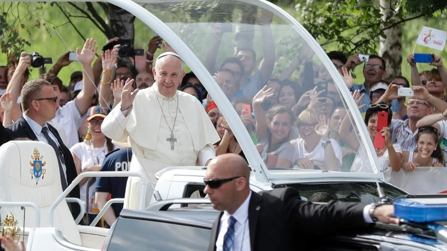 Pope Francis is cheered by faithful as he arrives to celebrate a mass at conclusion of the World Youth Day inKrakow, Poland, Sunday, July 31, 2016. The Mass was the final part of the World Youth Day, a global celebration of young Catholics, on the fifth day of the Pope's visit to Poland. (AP Photo/Gregorio Borgia)
