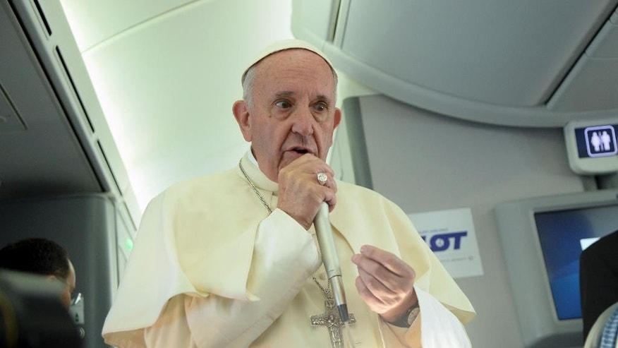 Pope Francis speaks to journalists on board the flight from Krakow, Poland, to Rome, at the end of his 5-day trip to southern Poland, Sunday, July 31, 2016. Francis announced that the next World Youth Day will take place in Panama in 2019. (Filippo Monteforte/Pool Photo via AP)
