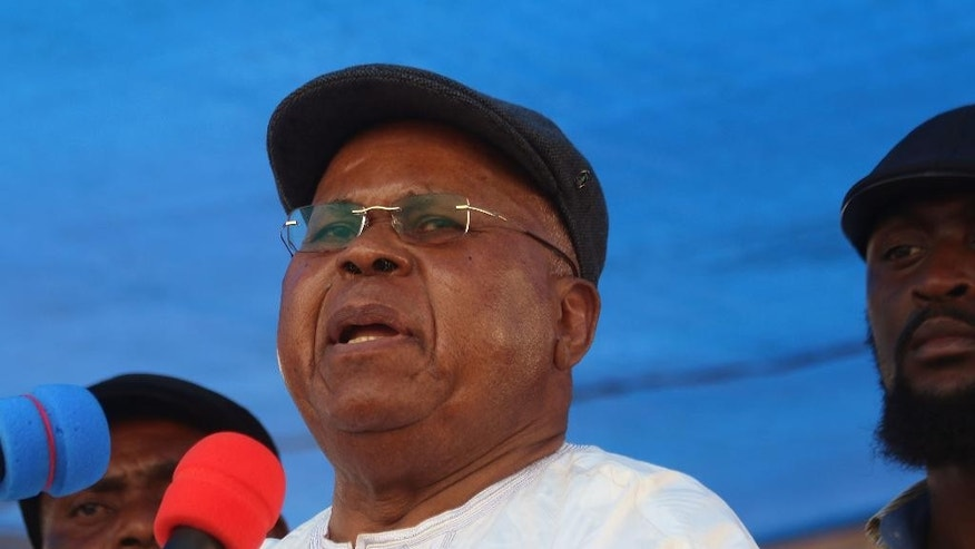 """Congo opposition leader Etienne Tshisekedi speak during a political rally in Kinshasa, Congo, Wednesday, July 31, 2016. Several thousand people, many wearing the blue, yellow and red colors of Congo's flag, gathered near the Stadium of Martyrs in Kinshasa Sunday holding banners that said """"No to a third term."""" (AP Photo/John Bompengo)"""