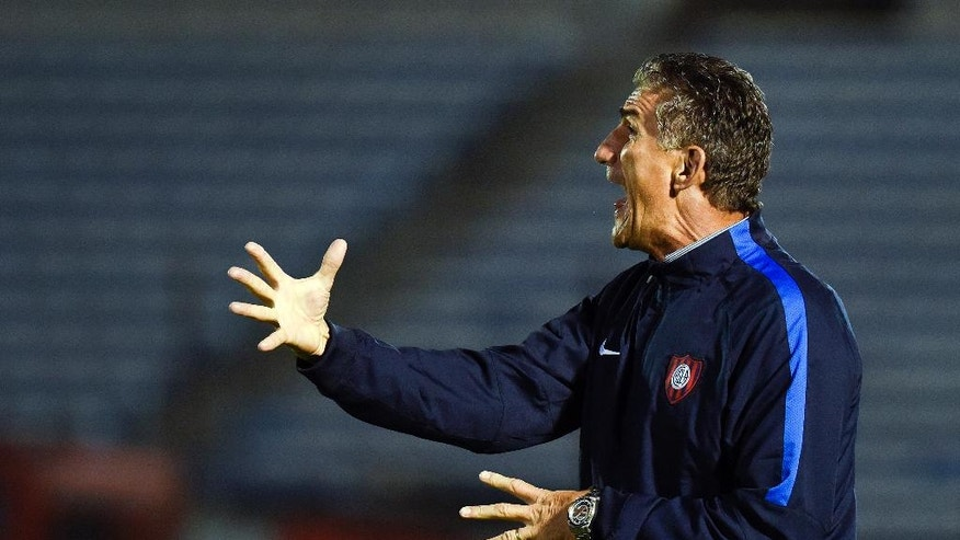 FILE - In this Feb. 19, 2015, file photo, Edgardo Bauza coach of Argentina's San Lorenzo reacts during a Copa Libertadores soccer game against Uruguay's Danubio in Montevideo, Uruguay. Bauza has been named on Monday, Aug. 1, 2016, as the new head coach of the Argentina national soccer team to replace Gerardo Martino. (AP Photo/Matilde Campodonico, File)