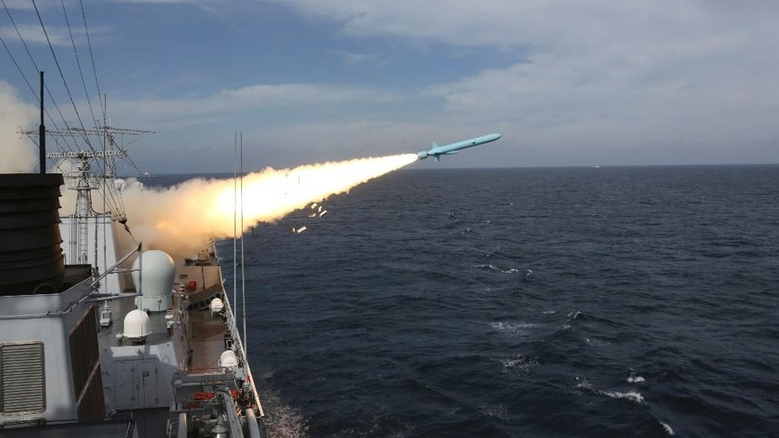 In this Monday, Aug. 1, 2016 photo released by Xinhua News Agency, a missile is launched from a guided-missile destroyer during a live ammunition drill in the East China Sea.  China's navy has fired dozens of missiles and torpedoes during exercises in the East China Sea that come amid heightened maritime tensions in the region, underscoring Beijing's determination to back up its sovereignty claims with force if needed. The live-fire drills that began Monday follow China's strident rejection of an international arbitration panel's ruling last month that invalidated Beijing's claims to a vast swath of the South China Sea. (Wu Dengfeng/Xinhua via AP)